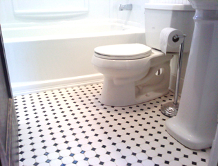 classic small black and white tile bathroom floor