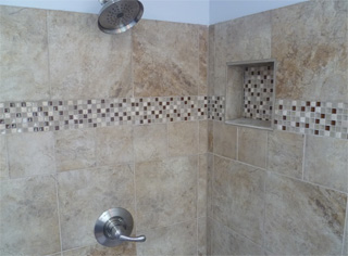 A Tile Corner Shower With Alcove Shelf